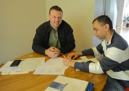 Real estate Victoria. I and Our Real Estate Agent-Ross Casey Completing Real Estate Documents.