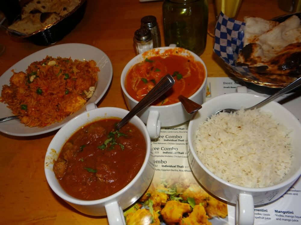 Combo C includes Chicken samosa, Butter chicken, Lamb curry, Rice,Naan and a Dessert