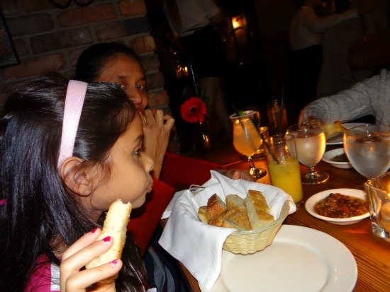 Lapaly snacking on Olive Tapenade with warm bread right from the oven at IL Terrazzo - Victoria BC